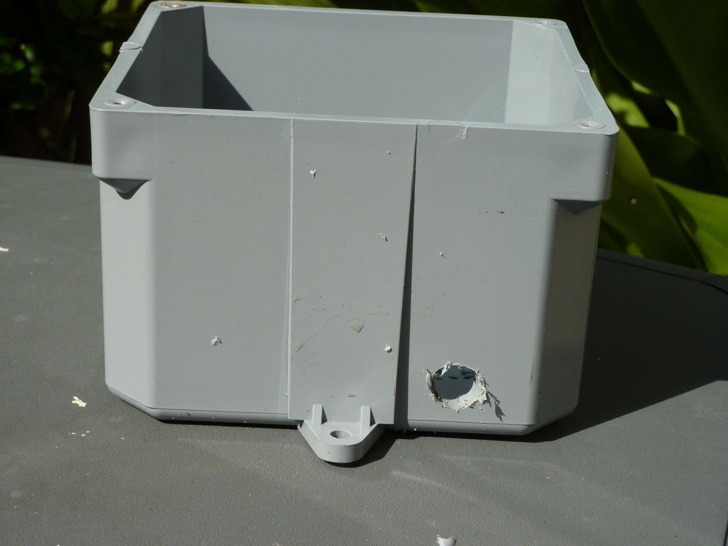 drilled hole in the outdoor dog fence water proof box