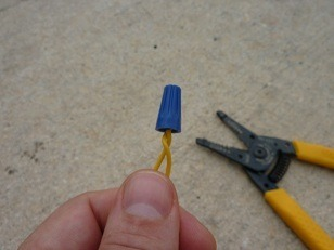 scrw the wire nut on the ends of the exposed dog fencing wire