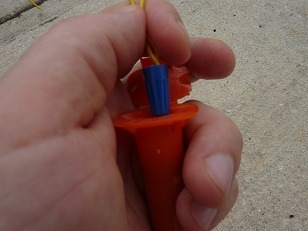 insert the wire nut to the bottom of the water proof splice tube