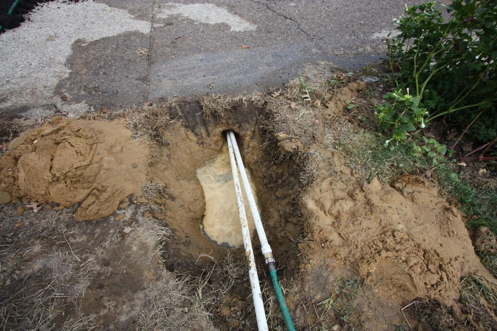 drive bullet mole under the driveway for electric fence wire